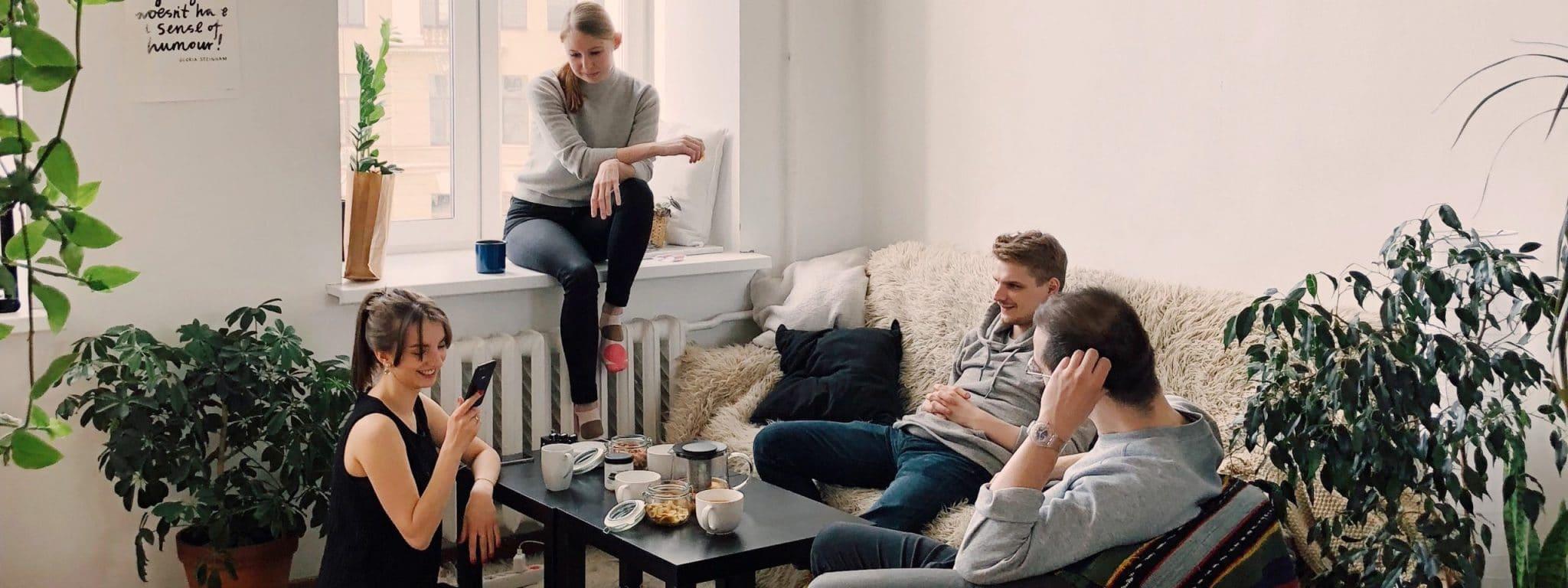 people gathered inside house sitting on sofa 1054974 scaled